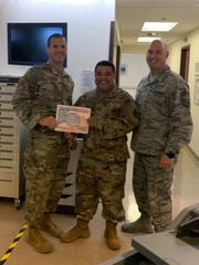 Justin Mendiola (center) of Pagat Mangilao, was awarded by the Wing Commander 60th Air Mobility Wing, Colonel Nelson, with Warrior of the Week for his efforts as MHS Genesis site point of contact. Mendiola along with his team from the 60th Medical Support Squadron at Travis Air Force Base underwent the long awaited MHS Genesis Go-Live. Mendiola guided his team in the deployment and configuration of 629 assets and the duty of assisting 2,500 users of the understanding of the new system. His systems team worked 12-18 hour shifts for two weeks ensuring the seamless transition of all hardware, software, and network interfaces within the facility. The Leidos Partnership for Defense Health called this one of the smoothest transitions they have seen in years. Mendiola gives credit to the support of his family, wife Tessie, daughters Kimora and Kendall, and son Eli and the Medical Information Systems Flight of the 60th Medical Support Squadron. He is a 2008 graduate from George Washington High School and has been in the U.S. Air Force for 11 years and counting.