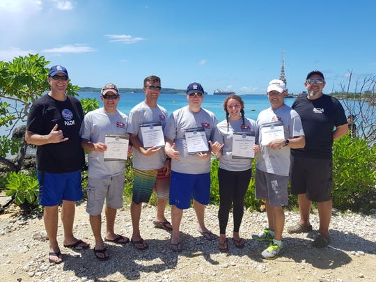 The newest PADI Professional Dive Instructors who recently passed their exams here on Guam with PADI and MDA. From left: Steve Clifford, PADI regional manager and examiner, students Jason Layfield, William Campbell, Chris Flemming, Lorissa Busse and Brent Shelley. Also in the photo is Wes Seleen, MDA course director. These four new instructors will be added to the nearly 40 instructors at Micronesian Divers Association, the Dive Force on Guam and in Micronesia.