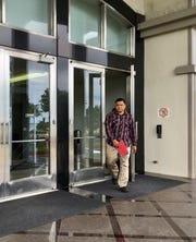 AnthonyNgirarois, a former member of the Guam National Guard, is sentenced to a year in prison after defraudingthe U.S. government of more than $40,000 through a National Guard recruitment program. He is pictured leaving the District Court of Guam on Monday, Oct. 21.