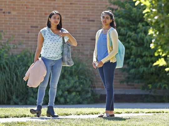 """The Miseducation of Bindu"" star Megan Suri, right, waits with fellow cast member Shingari Kuriakose for an upcoming scene during 2018 filming at Broad Ripple High School."