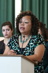 Shonna Majors, violence reduction director for the city of Indianapolis, speaks at a remembrance event for victims of domestic viloence on Oct. 1, 2019.