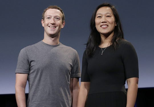 Facebook CEO Mark Zuckerberg and his wife, Priscilla Chan, smile as they prepare for a speech in San Francisco in 2016.