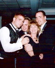 Mary Anne Coverdale, shown a couple of years before she was diagnosed with Alzheimer's disease, with sons Tom, Brad and Mark.