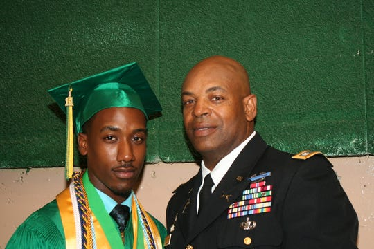 "Wilton Jackson II, now a reporter for the Clarion Ledger,  is with his dad, Lt. Col. Wilton ""Chuck"" Jackson, before his graduation from Jim Hill High School in 2011."