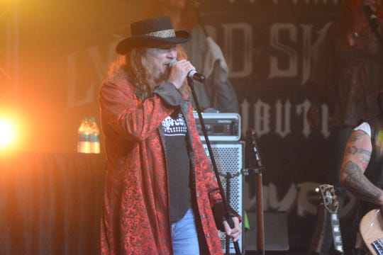Tommy Roxx, the lead singer of cover band Nuthin'Fancy belts out a popular Lynyrd Skynyrd tune at the Southwest Mississippi Community College in Summit on Oct. 19, 2019. Survivors and first responders of the plane crash that occurred more than 40 years ago spoke during the intermission of the show.