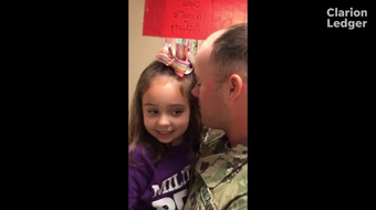 A military dad surprises his daughter at a Clinton elementary school