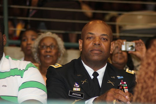 "Wilton Jackson's father, Army Lt. Col. Wilton ""Chuck"" Jackson, attends his son's graduation from Jim Hill High School in 2011 at the Mississippi Coliseum."
