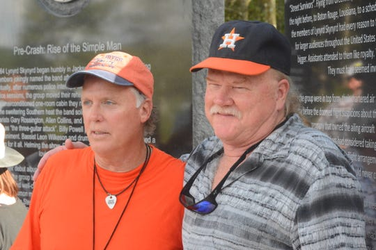 Lynyrd Skynyrd plane crash survivors Mark Howard, left, and Steve Lawler stand in front of a monument dedicated to those who died in the Oct. 20, 1977, crash. The two were at the monument unveiling ceremony 42 years later, on Oct. 20, 2019.