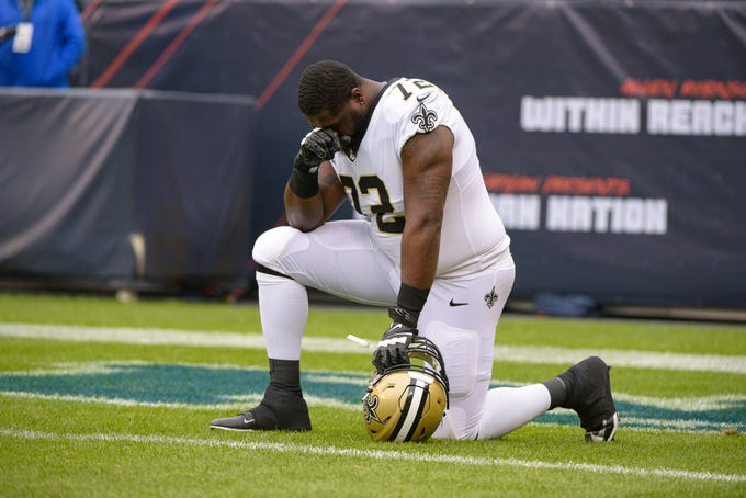 New Orleans Saints offensive tackle Terron Armstead (72) knees in the end zone before the start of an NFL football game against the Chicago Bears in Chicago, Sunday, Oct. 20, 2019. (AP Photo/Mark Black)