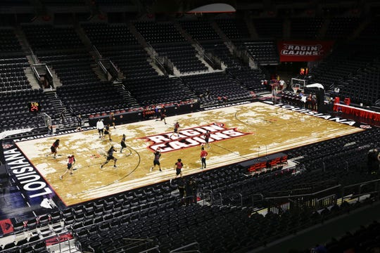 UL is replacing this swamp-design look of its floor at the Cajundome.