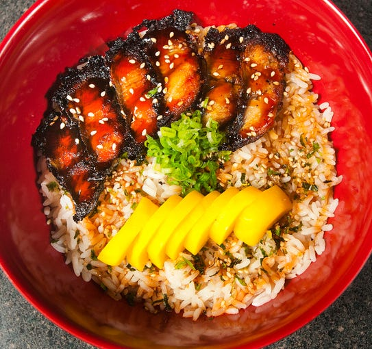 The Ramen House's unagi (eel) bowl starts with rice topped with furikake seasoning to which toasted eel in eel sauce is added. The dish also includes radish pickles and green onions and is topped with sesame seeds.09 October 2019