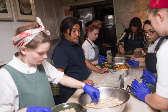 Chef Edward Lee and the Lee Initiative mentees prepare dinner at the James Beard House in New York City.