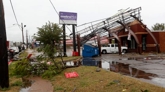 A powerful morning storm brought down power lines, trees and signs Monday, Oct. 21, 2019, along South Perkins Road near American Way in Memphis.