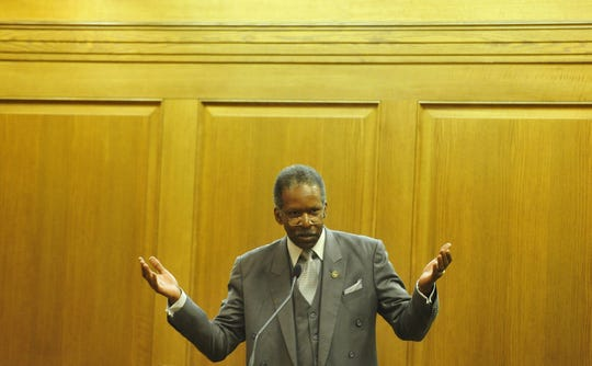 State Sen. Reggie Tate speaks during a hearing at Legislative Plaza in downtown Nashville, Tenn., June 9, 2015. Tate was found dead in his home Monday morning. He was 65.