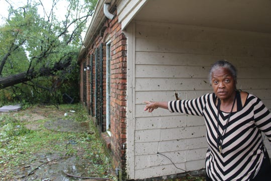Deloris Lewis points to a tree that was uprooted and fell on top of the home she stays in with her Daughter on Monday, Oct. 21, 2019.