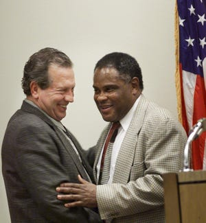 Republican Bubba Pleasant, left, exchanges pleasantries with old friend and former legislator, Rufus Jones, before a business tax study committee meeting in this 1996 file photo.