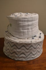 Abigail Austin, owner of Wholesome Diaper Co., creates cloth diaper cakes. This is one she is in the process of making.