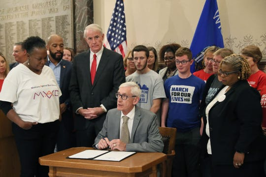 Gov. Tony Evers held a press conference at Milwaukee City Hall signing an executive order calling a special session on gun laws.