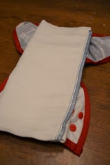 For cloth diapering, prefolds are placed inside of covers.