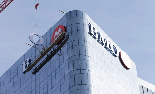 "The ""O"" dangles Friday as workers continue installation of the new sign on the BMO Tower, 790 N. Water St."