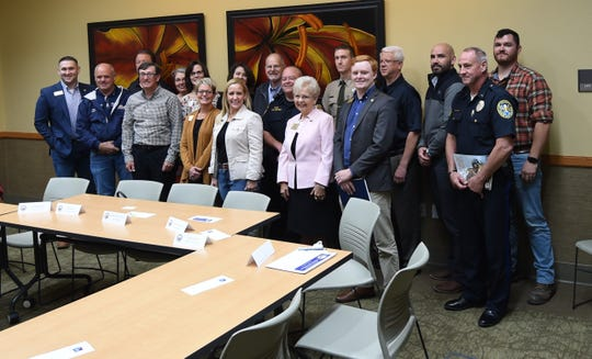 The attendees at the Baxter County roundtable discussion with Arkansas Attorney General Leslie Rutledge gather for a group photo Monday afternoon.