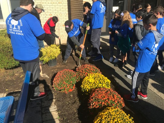 Contractors, students and other volunteers helped landscape and secure the property of Central School in East Hanover as part of the annual One Day One School program. Oct. 19, 2019.