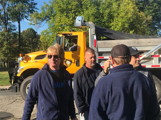 """Hanover Committeeman and event organizer Thomas """"Ace"""" Gallagher, left, meets with contractors, students and other volunteers who helped landscape and secure the property of Central School in East Hanover as part of the annual One Day One School program. Oct. 19, 2019."""