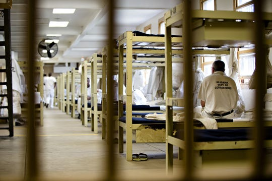 Inmates sit on their bunks at Draper Correction Facility in Elmore County on Feb. 6. Opened in 1939, Draper Correction Facility was the oldest correction facility in the state of Alabama until it was closed in 2018. Albert Cesare/Advertiser