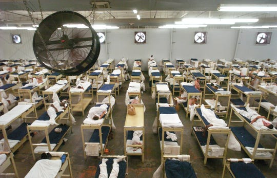 Fans keep the air moving in G Dorm at Staton Correctional Facility in Spiegner, AL., as seen Thursday, August 11, 2005. G Dorm has 360 beds. Montgomery Advertiser, Lloyd Gallman