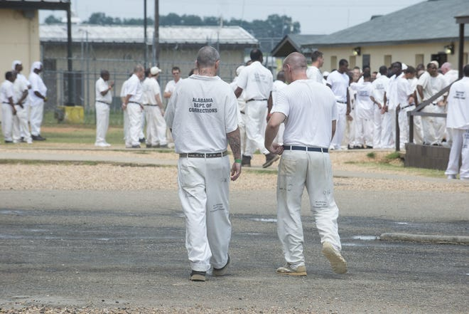 Inmates are in the yard on Thursday, July 17, 2015, at Elmore Correctional Facility in Elmore. A new prison construction plan could allocate  COVID money to allow work to begin immediately.