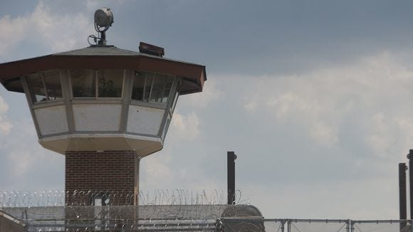 State officials are still negotiating lease agreements over three proposed men's prisons.