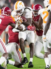 Alabama kicker Ty Perine (99) and wide receiver Henry Ruggs, III, (11) tackle Tennessee wide receiver Marquez Callaway (1) on a punt return at Bryant-Denny Stadium in Tuscaloosa, Ala., on Saturday October 19, 2019.