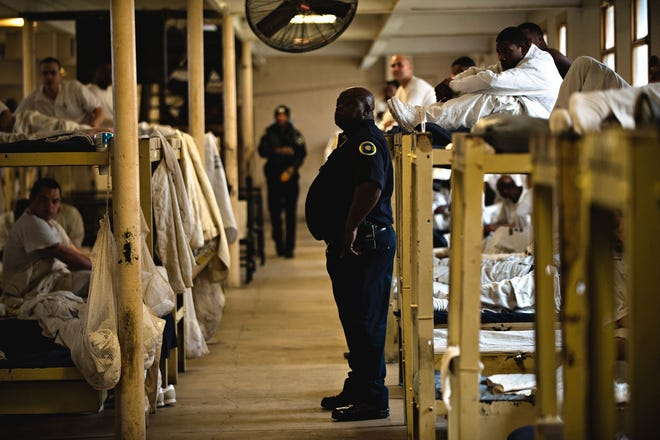 Albert Cesare/Advertiser file Inmates sit on their bunks at Draper Correction Facility in Elmore County on  Feb. 6.  Opened in 1939, Draper Correction Facility was the oldest correction facility in the state of Alabama until it was closed in 2018.