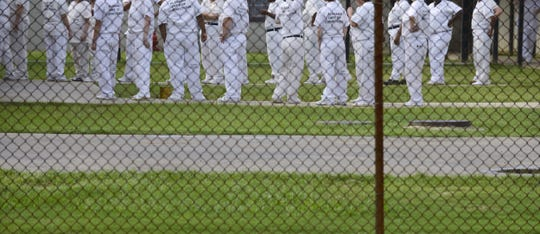 Inmates line up for the dining hall inside Julia Tutwiler Prison on Wednesday, Sept. 4, 2013. (Montgomery Advertiser, Lloyd Gallman)