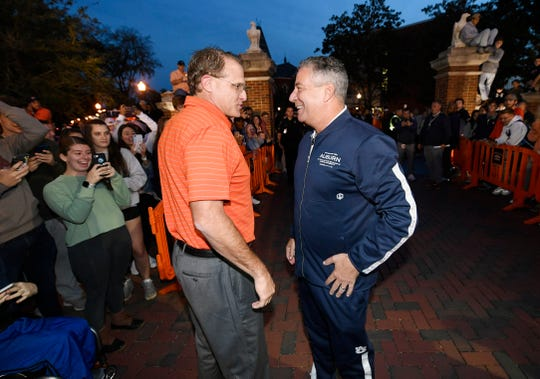 Auburn coaches Gus Malzahn, center left, and Bruce Pearl, right talk at Tipoff at Toomer's on Thursday, Oct. 17, 2019, in Auburn, Ala.