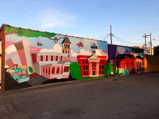 A finished version of the cityscape that was painted during the Boro Arts Mural Festival on Oct. 19, 2019. The paint-by-number mural was designed by renowned artist Norris Hall, along with a committee. The mural is located on the outside wall of Vine Street Market in downtown Murfreesboro. More murals will be coming to various locations across Rutherford County, spearheaded in part by the Rutherford Arts Alliance.