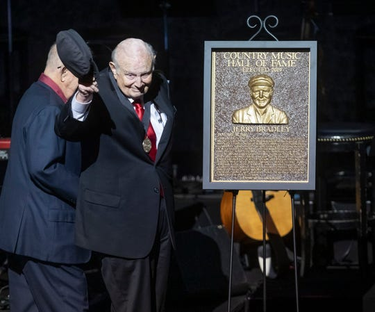 Jerry Bradley waves his hat to the crowd as his Country Music Hall of Fame plaque is revealed during the Medallion Ceremony at the Country Music Hall of Fame Sunday, October 20, 2019.