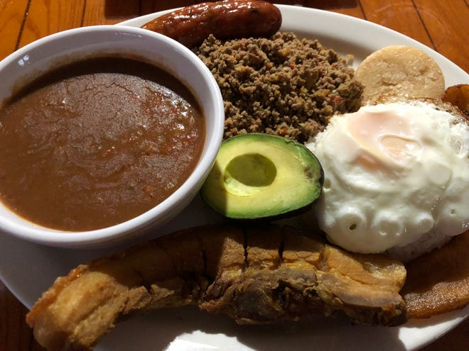 The Colombian bandeja paisa ($19) from Tiki Cantina & Fusion Restaurant in Bonita Springs features grilled steak, chicharron, chorizo, a fried egg, white rice, a fried sweet plantain, avocado and an arepa.