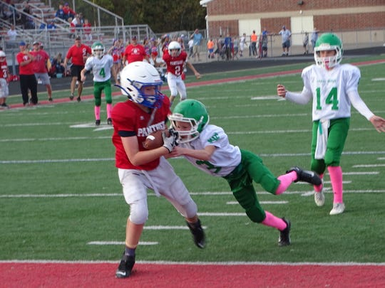 Licking Valley Red's Gideon Riley catches a touchdown pass during Sunday's during Sunday's Licking County League Youth Football Bruce Varner Division semifinal at Randy Baughman Stadium. Licking Valley Red beat Newark Catholic 20-18 in overtime.