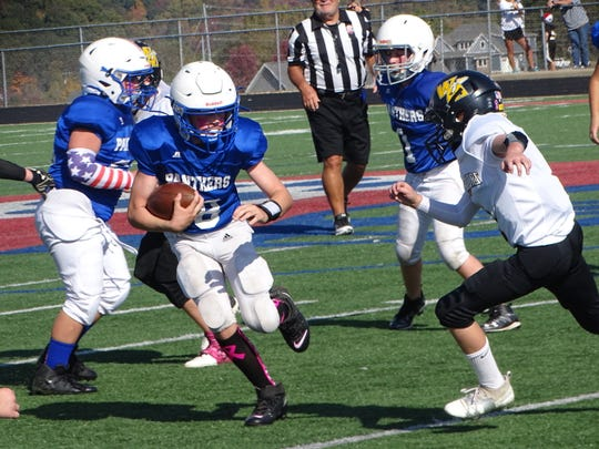 Dylan Copper carries the ball for Licking Valley Blue during Sunday's Licking County League Youth Football Bruce Varner Division semifinal at Randy Baughman Stadium. Licking Valley Blue fell to Watkins Memorial White 20-8.