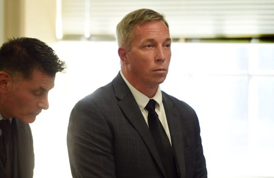 John P. Daley, who was charged with placing a camera in female bathrooms, is seen with his defense lawyer James M. Porfido during his arraignment before Morris County Judge Stephen Taylor at the County Courthouse on Oct. 21, 2019.