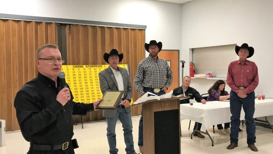 Law Enforcement Director to Crime Stoppers Cpl. Theo Livingston presents Crime Stopper of the Year award to Otero County Sheriff's Deputy Preston Eldridge, also pictured are Otero County Sheriff David Black, Preston and Teddy Eldridge.