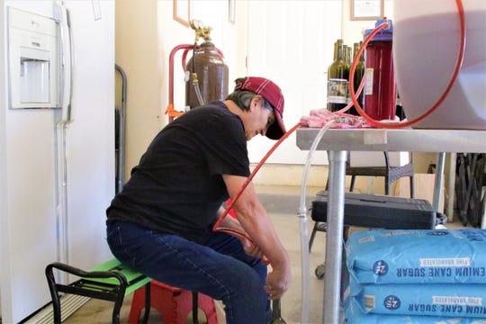 Anita Martinez, co-owner of Rio Suave Vineyard, bottles wine in her garage on Oct. 18, 2019.