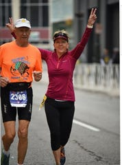 Bob Ranta, 87, of South Lyon, with his niece, Sandy Logan, 57, of Northville, run in the Detroit Free Press Marathon on Sunday, Oct. 20, 2019.