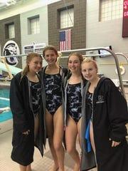 South Lyon East divers Sophia Ohland, Kate Benjamin, Alyssa Mayer, Maia King celebrate after a meet win.