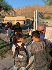 Superintendent Scott Bailey greets children from Madison Elementary School to their first day at Adams Early Childhood Learning Center in La Quinta on Monday morning, Oct. 21, 2019. They'll likely spend the rest of the school year there as Madison undergoes repairs.
