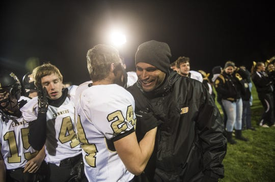 In this file photo, Biglerville head coach Alex Ramos congratulates player Nate Newberry after Biglerville defeated Hanover on Friday Nov. 13, 2015 during the first round of district playoffs at Sheppard-Myers Stadium in Hanover. Ramos announced his resignation last week after 10 seasons with the Canners.