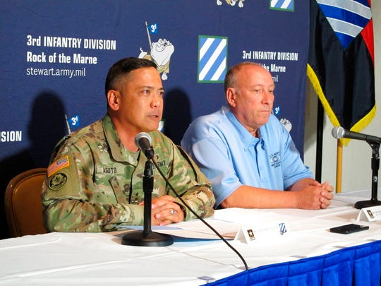 Army Maj. Gen. Antonio Aguto (left) and Army accident investigator Michael Barksdale hold a news conference on Oct. 21, 2019, at Fort Stewart, Ga., about a training accident that killed three soldiers and injured three others.
