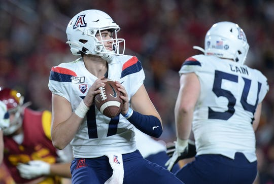 Arizona Wildcats quarterback Grant Gunnell (17) drops back to pass against the Southern California Trojans during the second half at the Los Angeles Memorial Coliseum.