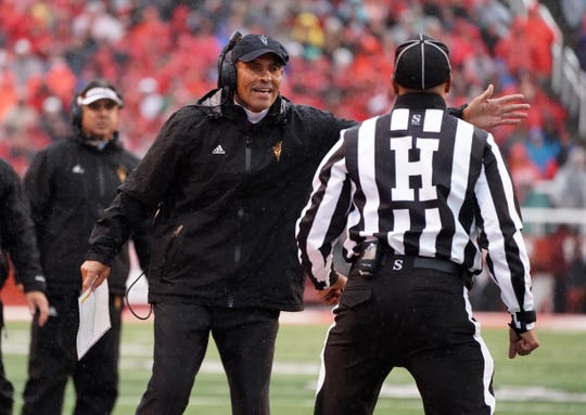 Arizona State Sun Devils head coach Herm Edwards argues with an official in the first quarter against the Utah Utes at Rice-Eccles Stadium